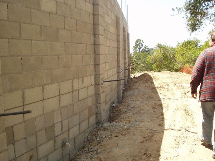 Design and Inspection of New Retaining Wall with CMU and Helical Screw Tiebacks