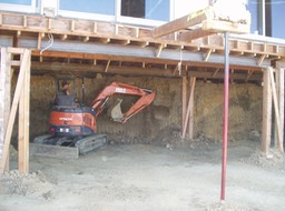 Excavation underneath house for underpinning and new basement