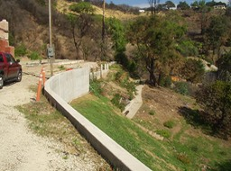 New Retaining Wall with Caissons and Tiebacks after Landslide