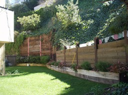 Wood Retaining Wall with Soldier Piles and Tiebacks